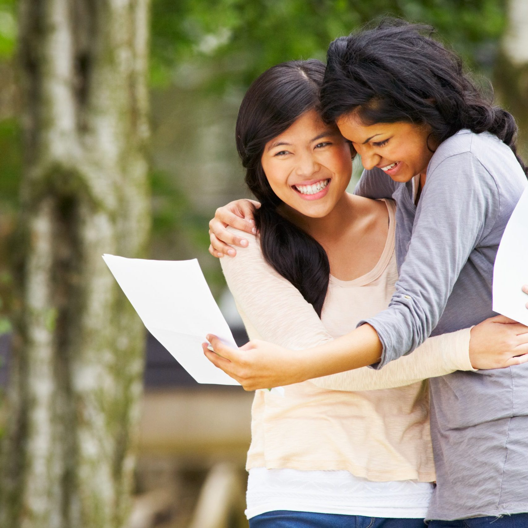 Two Teenage Girls Celebrating Successful Exam Results And Hugging