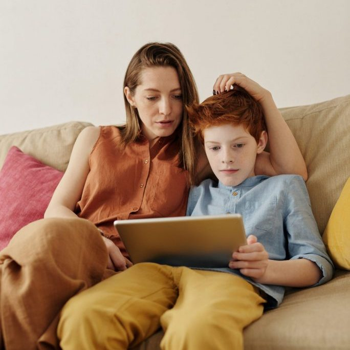 photo-of-woman-and-boy-watching-through-tablet-computer-4145349